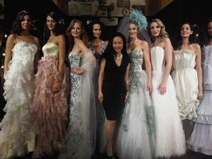 Luly surrounded by her couture creations